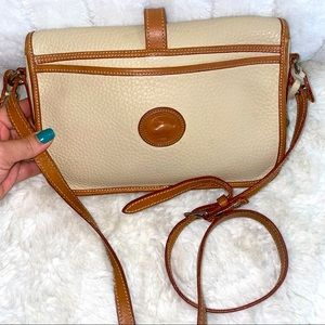 Dooney & Bourke vintage cream crossbody bag